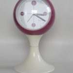 Clocks Blessing two jewels rhythm,Magenta Blessing clock, white pedestal tulip base, made in west Germany. Space age era, made of plastic from the early 1970s