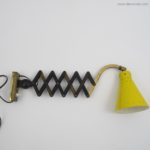 Yellow scissors wall lamp from the 60s